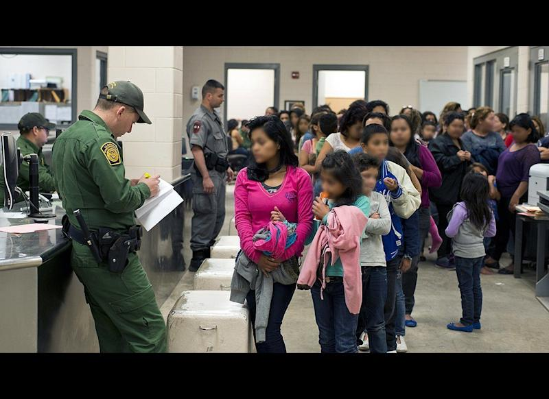 In south Texas, U.S. Customs and Border Protection officers process unaccompanied children after they have crossed the border into the United States. (Hector Silva — Customs and Border Protection)