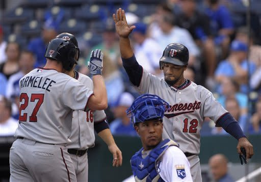 Minnesota Twins' Chris Parmelee (27) is congratulated at home plate by teammate Ryan Doumit (18) after hitting a three-run home run in the first inning during the second baseball game of a doubleheader, Saturday, Sept. 1, 2012, in Kansas City, Mo. (AP Photo/Reed Hoffmann)
