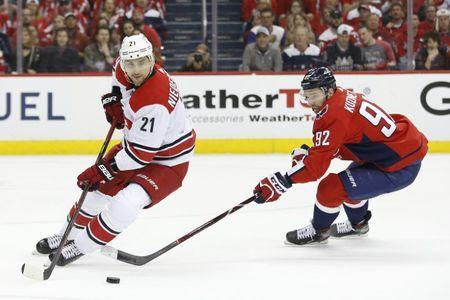 Apr 20, 2019; Washington, DC, USA; Carolina Hurricanes right wing Nino Niederreiter (21) skates with the puck as Washington Capitals center Evgeny Kuznetsov (92) chases in the first period in game five of the first round of the 2019 Stanley Cup Playoffs at Capital One Arena. Mandatory Credit: Geoff Burke-USA TODAY Sports