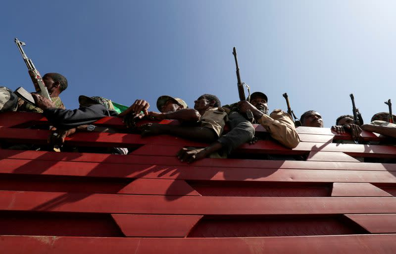 FILE PHOTO: Militia members from Ethiopia's Amhara region ride on their truck as they head to face the Tigray People's Liberation Front (TPLF), in Sanja, Amhara