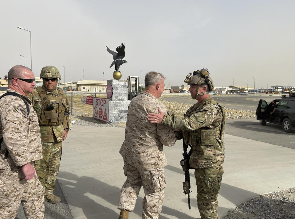 U.S. Marine Corps Gen. Frank McKenzie, center, the commander of U.S. Central Command, meets with U.S. Navy Rear Adm. Peter Vasely, commander of U.S. Forces Afghanistan-Forward, at Hamid Karzai International Airport, Kabul, Afghanistan, Tuesday, Aug. 17, 2021. (Capt. William Urban/U.S. Navy via AP)