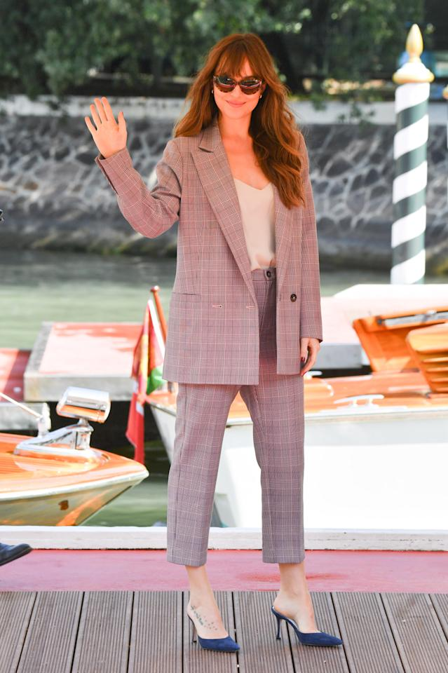<p>Wearing a checked trouser suit by Danish favourite GANNI, Dakota gave us all the workwear goals. <em>[Photo: Getty]</em> </p>