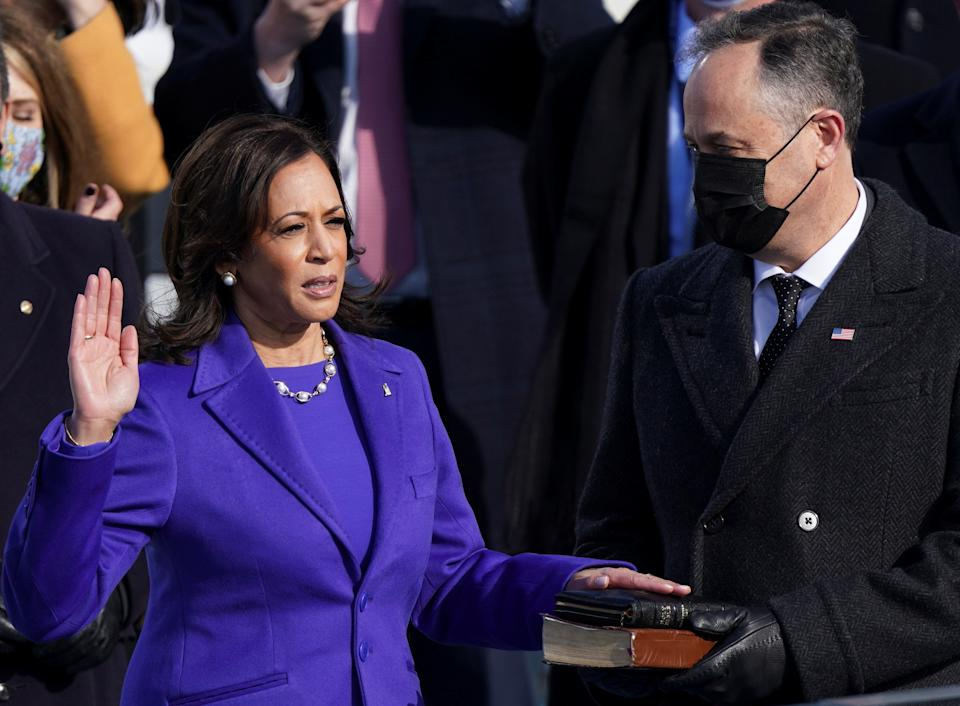 Kamala Harris is sworn in as U.S. Vice President as her spouse Doug Emhoff holds a bible during the inauguration of Joe Biden as the 46th President of the United States. (Kevin Lamarque/Reuters)