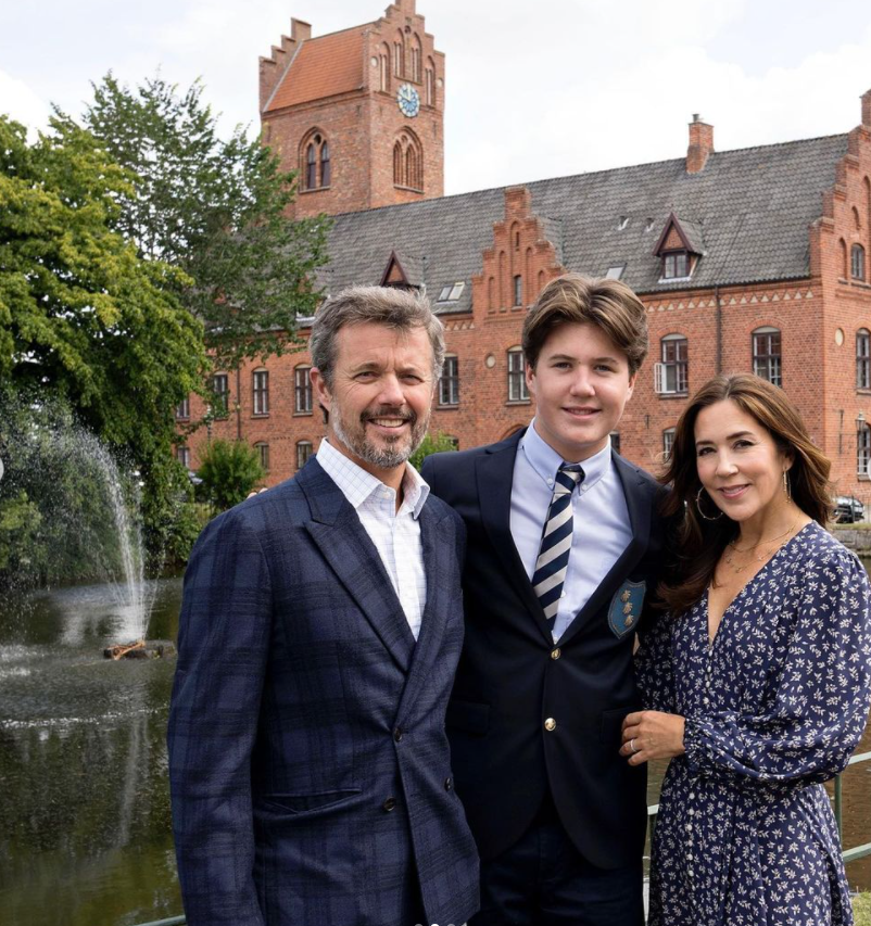 <p>Proud parents Crown Prince Frederik and Crown Princess Mary of Denmark pose with their eldest son Christian on his first day at boarding school. Photo: Instagram/detdanskekongehus</p>