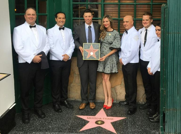 Mark Echeverria, co-owner of Hollywood restaurant Musso & Frank Grill, his wife Tina Echeverria and restaurant staff celebrated its 100th anniversary