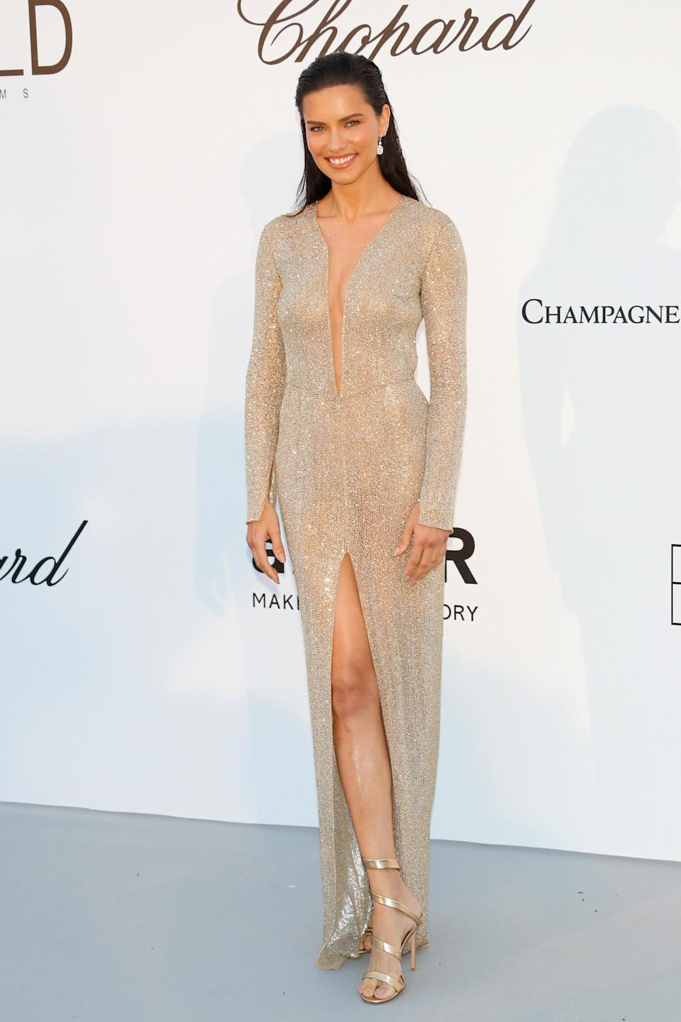 <p>For the 2018 amfAR Gala in Cannes, Adriana Lima wore a metallic thigh-high split dress and looked every inch the supermodel. [Photo: Getty] </p>