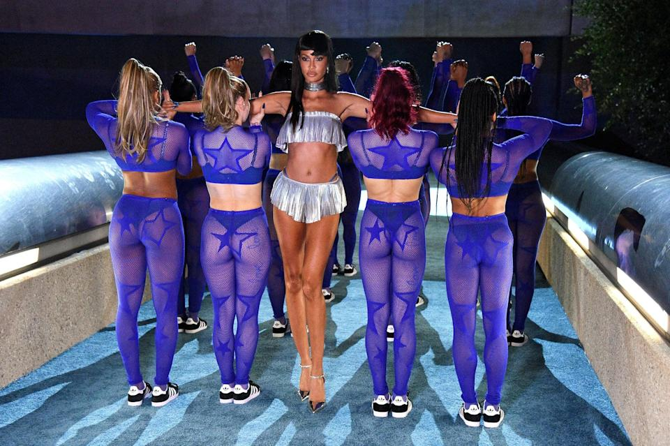 <p>The supermodel looked like royalty gliding down the runway.</p>