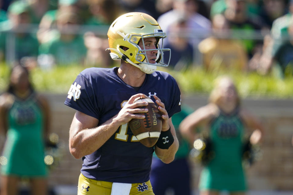Notre Dame quarterback Jack Coan faces some familiar faces on Saturday at Soldier Field in facing his former Wisconsin program. (AP Photo/Michael Conroy)