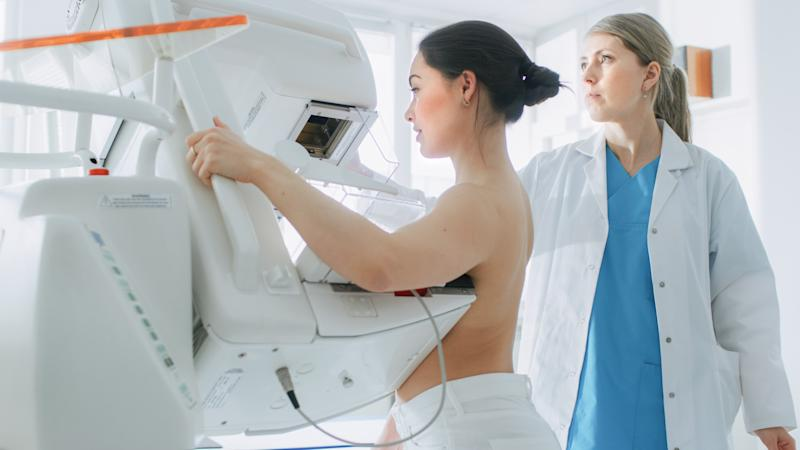 In the Hospital, Portrait Shot of Topless Female Patient Undergoing Mammogram Screening Procedure. Healthy Young Female Does Cancer Preventive Mammography Scan. Modern Hospital with High Tech Machines.