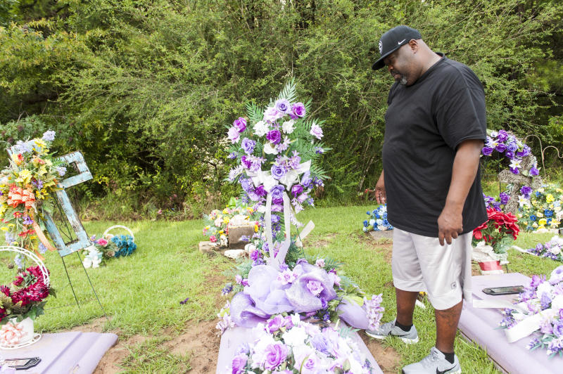 Vincent Mitchell looks at his wife's grave at a cemetery in Bogue Chitto. (Melissa Jeltsen/HuffPost)