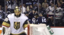 Winnipeg Jets' Dmitry Kulikov (5), Tyler Myers (57), Kyle Connor and Bryan Little (18) celebrate after Connor scored a short-handed goal on Vegas Golden Knights goaltender Marc-Andre Fleury, foreground, during the second period of an NHL hockey game Tuesday, Jan. 15, 2019, in Winnipeg, Manitoba. (Trevor Hagan/The Canadian Press via AP)