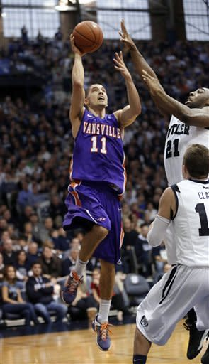 Evansville guard Colt Ryan, left, shoots over the defense of Butler forward Roosevelt Jones (21) during the second half of an NCAA college basketball game, Saturday, Dec. 22, 2012, in Indianapolis. Butler won 75-67. (AP Photo/AJ Mast)