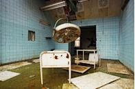 <p>Rusty medical equipment clutters this partially flooded operating room.<br></p>