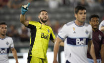 Vancouver Whitecaps goalkeeper Maxime Crepeau directs his teammates as players set up for a corner kick by the Colorado Rapids in the first half of an MLS soccer match Sunday, Sept. 19, 2021, in Commerce City, Colo. (AP Photo/David Zalubowski)