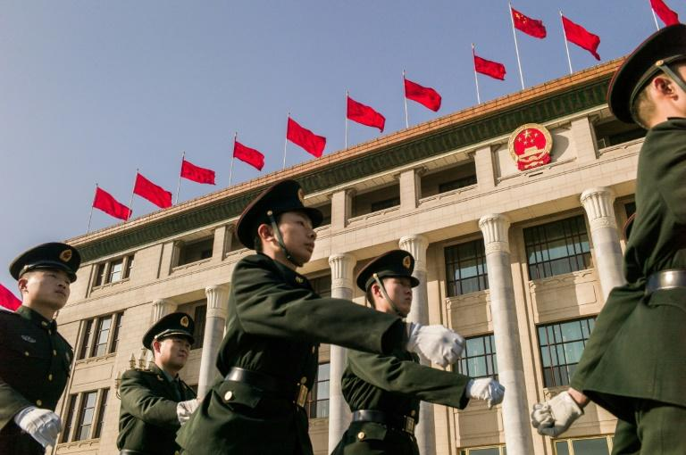 Chinese soldiers march past the Great Hall of the People ahead of the opening session of the Chinese People's Political Consultative Conference (CPPCC) in Beijing, on March 2, 2017