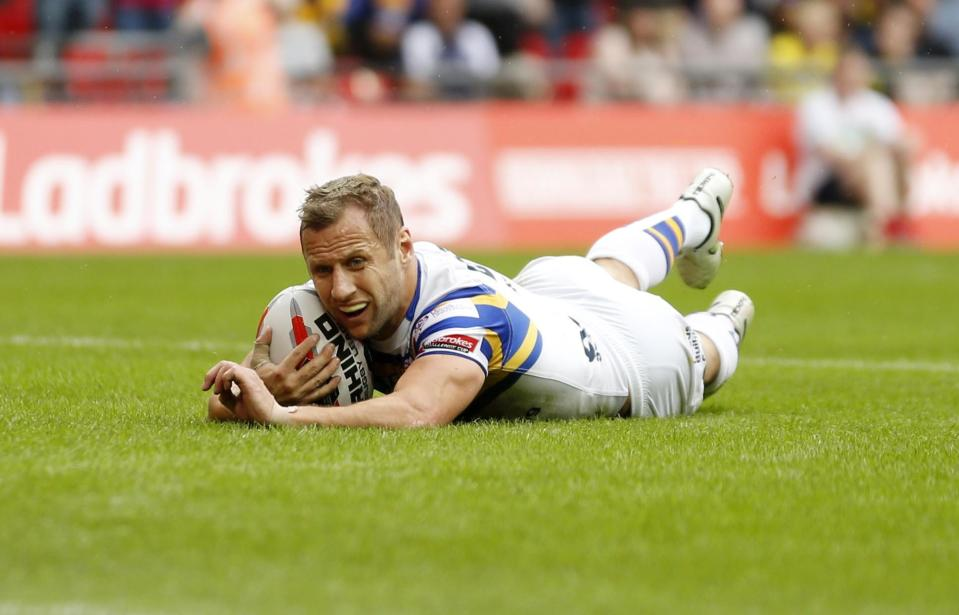 Leeds Rhinos' Rob Burrow scores their seventh try during the Ladbrokes Challenge Cup Final at Wembley Stadium, London.