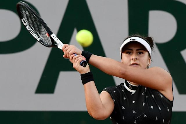Canada's Bianca Andreescu in action against Czech Marie Bouzkova in the first round of the French Open (AFP Photo/Philippe LOPEZ)