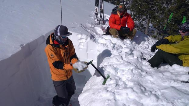 A lesson in snowpack physics by guide Chris Marshall. / Credit: CBS News