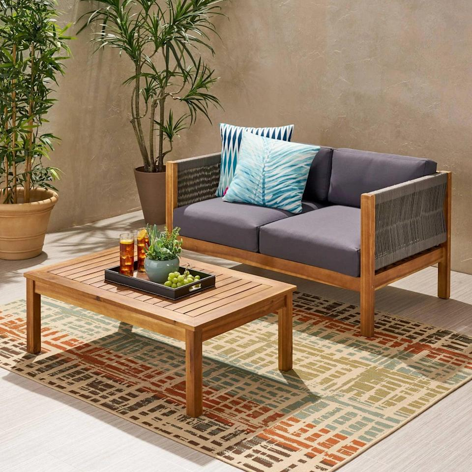 <p>Establish an outdoor space that's cozy, comfortable, and stylish with the <span>Laurel Acacia Wood Loveseat Set</span> ($460).</p>
