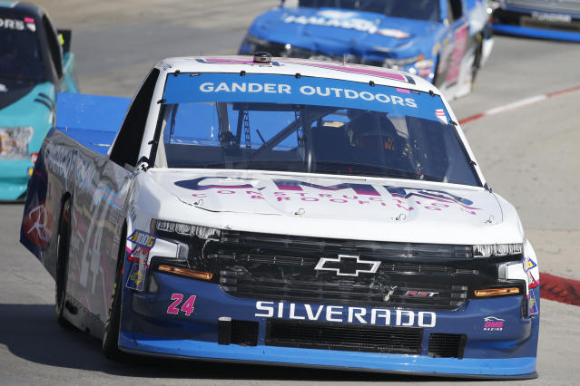 FILE - In this Oct. 26, 2019, file photo, Brett Moffitt (24) competes during a NASCAR Truck Series race at Martinsville Speedway, in Martinsville, Va. The NASCAR Truck Series has its championship race Friday, Nov. 15, 2019, at Homestead-Miami Speedway. Brett Moffitt, Matt Crafton and Stewart Friesen join Ross Chastain in the championship field. Moffitt is the defending series champion and will try to become the first repeat winner since Crafton in 2013 and 2014. (AP Photo/Steve Helber, File)