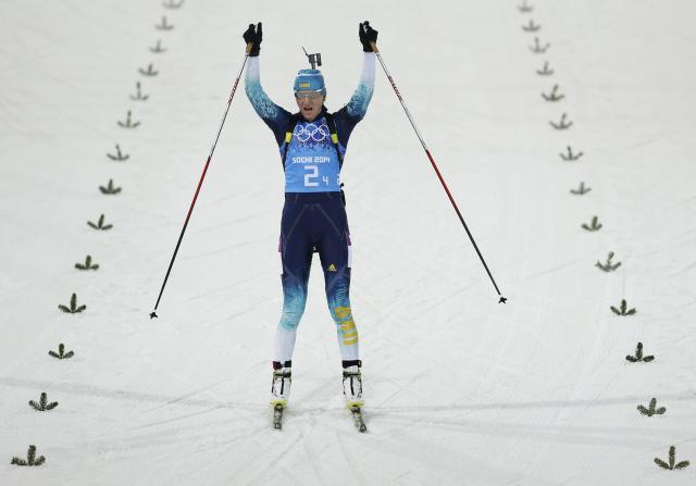 Ukraine's Olena Pidhrushna celebrates as she crosses the finish line to win the women's biathlon 4x6 km relay event at the Sochi 2014 Winter Olympic Games February 21, 2014. REUTERS/Stefan Wermuth (RUSSIA - Tags: OLYMPICS SPORT BIATHLON TPX IMAGES OF THE DAY)