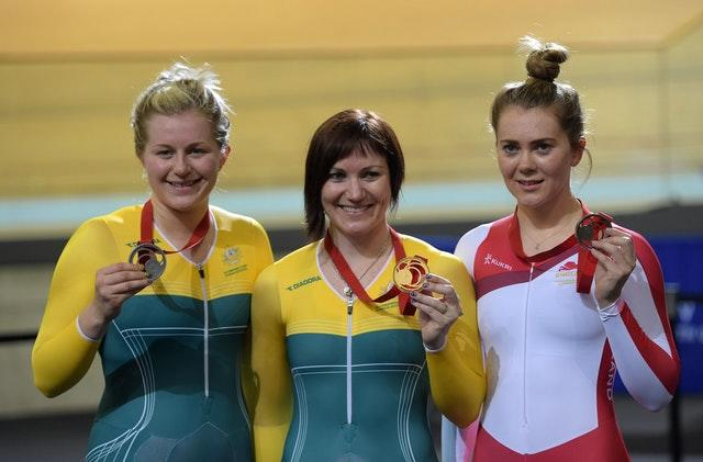 Varnish, right, collecting a bronze medal at the 2014 Commonwealth Games