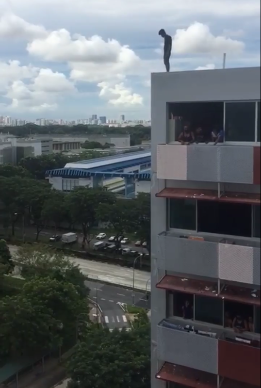 A 19-year-old migrant worker perched atop a block at Sungei Tengah Lodge, who was later apprehended under the Mental Health Act. SCREENCAP: Singapore to Bangladesh Facebook page