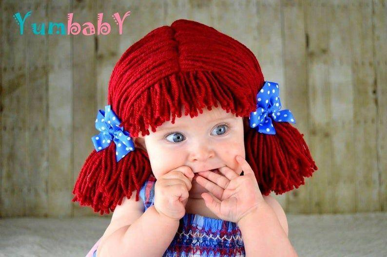 """<p><strong>YumbabY</strong></p><p>etsy.com</p><p><strong>$29.95</strong></p><p><a href=""""https://go.redirectingat.com?id=74968X1596630&url=https%3A%2F%2Fwww.etsy.com%2Flisting%2F110249840%2Fraggedy-ann-wig-baby-hat-newborn&sref=https%3A%2F%2Fwww.goodhousekeeping.com%2Fholidays%2Fhalloween-ideas%2Fg4570%2Fbest-baby-halloween-costumes%2F"""" rel=""""nofollow noopener"""" target=""""_blank"""" data-ylk=""""slk:Shop Now"""" class=""""link rapid-noclick-resp"""">Shop Now</a></p><p>The best time to dress your child as Raggedy Ann: When they're still small enough to be carried around like an actual doll. This listing is just for the wig — <a href=""""https://www.amazon.com/Morris-Costumes-1330-12118-RAGGEDY-BUNTING/dp/B001BXLNVA?tag=syn-yahoo-20&ascsubtag=%5Bartid%7C10055.g.4570%5Bsrc%7Cyahoo-us"""" rel=""""nofollow noopener"""" target=""""_blank"""" data-ylk=""""slk:the dress"""" class=""""link rapid-noclick-resp"""">the dress</a> is sold separately (or you can just use a blue dress with a white pinafore). </p>"""