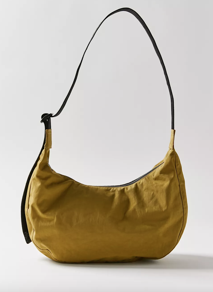 """<br><br><strong>Baggu</strong> Medium Crescent Nylon Shoulder Bag, $, available at <a href=""""https://go.skimresources.com/?id=30283X879131&url=https%3A%2F%2Fwww.urbanoutfitters.com%2Fshop%2Fbaggu-medium-crescent-nylon-shoulder-bag"""" rel=""""nofollow noopener"""" target=""""_blank"""" data-ylk=""""slk:Urban Outffiters"""" class=""""link rapid-noclick-resp"""">Urban Outffiters</a>"""