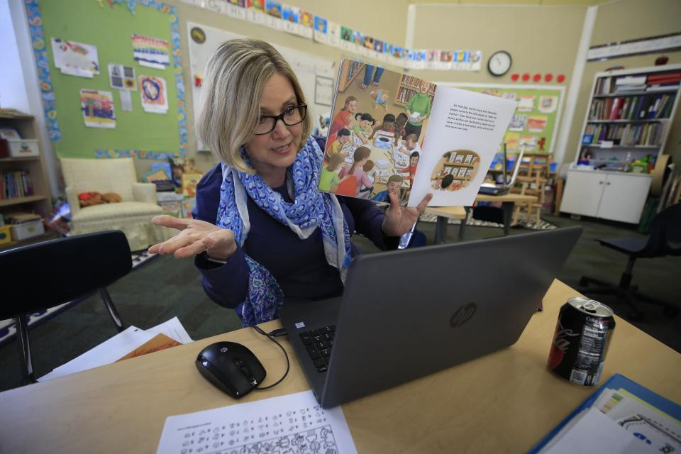 Joanne Collins Brock , a second grade teacher at St Francis School (Goshen), teaches online in her empty classroom on April 15, 2020 in Goshen, Kentucky. (Photo by Andy Lyons/Getty Images)
