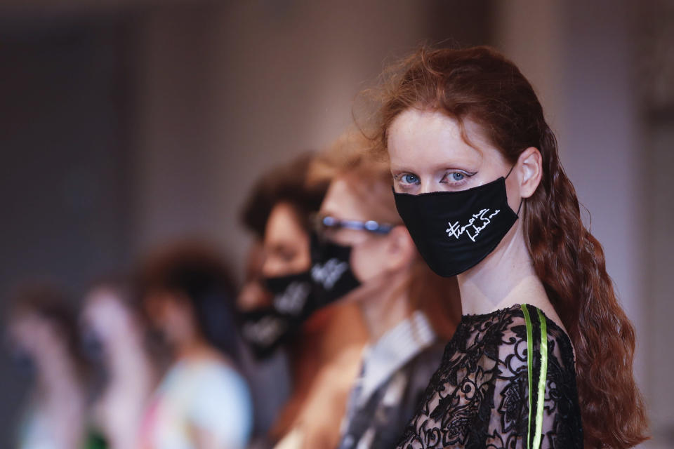 Models wear creations as part of the Francesco Liberatore 2021 women's spring-summer ready-to-wear collection during the Milan's fashion week in Milan, Italy, Friday, Sept. 25, 2020. (AP Photo/Antonio Calanni)