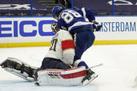 Tampa Bay Lightning right wing Nikita Kucherov (86) runs into Florida Panthers goaltender Chris Driedger (60) during the second period in Game 4 of an NHL hockey Stanley Cup first-round playoff series Saturday, May 22, 2021, in Tampa, Fla. (AP Photo/Chris O'Meara)