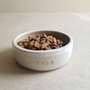 """<p>Treat your fur baby to their very own hand thrown stoneware bowl, personalised with their name. <br></p><p>£25 <a href=""""https://www.etsy.com/uk/listing/470451451/personalised-pet-bowls-handthrown?ga_order=most_relevant&ga_search_type=all&ga_view_type=gallery&ga_search_query=pet&ref=sr_gallery_31"""" rel=""""nofollow noopener"""" target=""""_blank"""" data-ylk=""""slk:Kara Leigh Ford"""" class=""""link rapid-noclick-resp"""">Kara Leigh Ford</a></p>"""