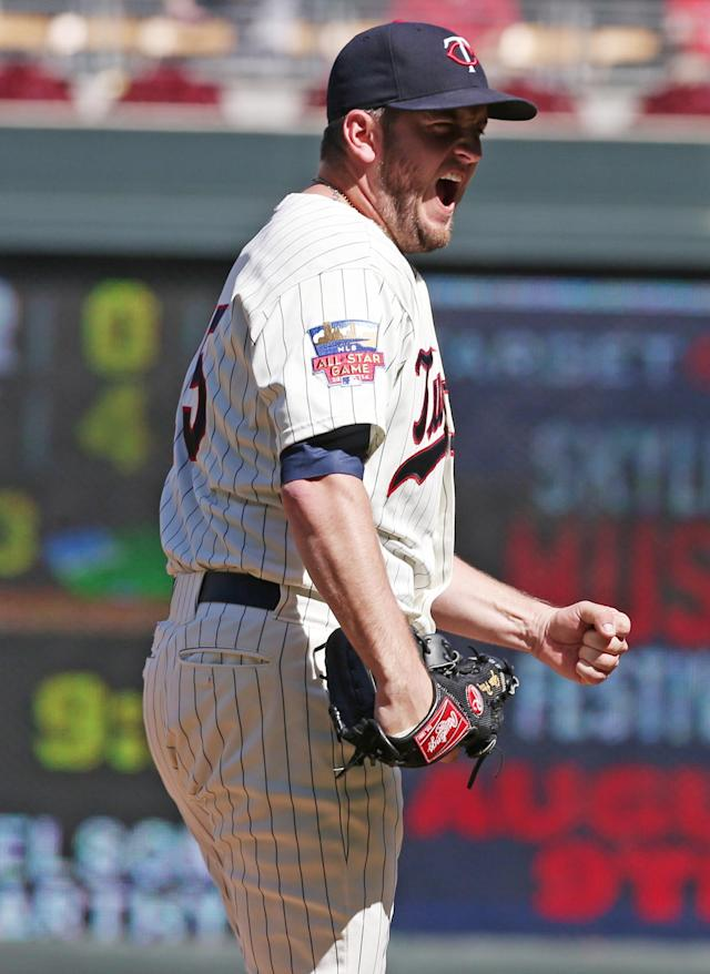 Minnesota Twins' pitcher Glen Perkins pumps his fist in celebration after striking out Chicago White Sox' Adam Dunn for the final out in the Twins' 4-3 win in a baseball game, Saturday, June 21, 2014, in Minneapolis. Perkins earned the save. (AP Photo/Jim Mone)