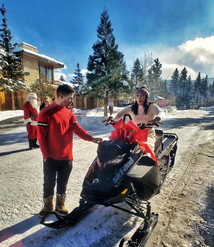 """Special delivery from... Santa! The big man himself drove in on Priyanka Chopra's gift from husband Nick.  """"Santa drove in on my bat mobile!! Aaaah!"""" Chopra wrote on Instagram of her brand new <a href=""""https://people.com/music/nick-jonas-surprises-priyanka-chopra-christmas-snowmobile/"""">snowmobile</a>. """"My husband knows me so well! Thank you baby. I love you!""""  Nick said of his wife's reaction, """"Nothing better than seeing her smile."""""""