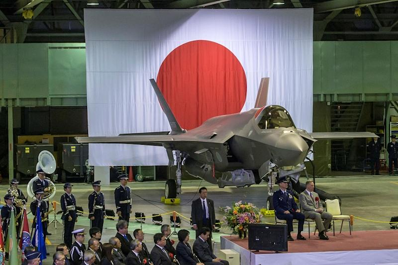 Senior leaders of Japan's Ministry of Defense, U.S. Forces Japan, Pacific Air Forces and Lockheed Martin gather in a Japan Air Self-Defense Force hangar for the commemorative ceremony welcoming the first operational F-35A Lightning II to JASDF's 3rd Air Wing at Misawa Air Base, Japan, February 24, 2018. Picture taken February 24, 2018. U.S. Air Force/Tech. Sgt. Benjamin W. Stratton/Handout via REUTERS