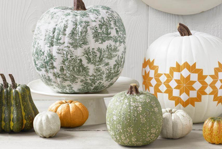 """<p>Press a pretty pattern like toile or any printed image onto a squash for a detailed yet easy look. </p><p><em><a href=""""http://www.countryliving.com/diy-crafts/how-to/a4177/decoupage-a-pumpkin/"""" rel=""""nofollow noopener"""" target=""""_blank"""" data-ylk=""""slk:Get the tutorial at Country Living »"""" class=""""link rapid-noclick-resp"""">Get the tutorial at Country Living »</a></em></p>"""