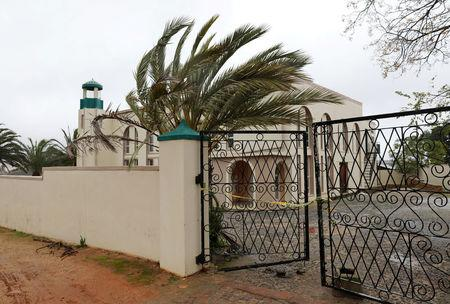 Police tape cordons off a mosque after a knife attack in Malmesbury near Cape Town