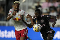 New York Red Bulls forward Fabio Gomez, left, vies with Inter Miami midfielder Blaise Matuidi during the first half of an MLS soccer match, Friday, Sept. 17, 2021, in Fort Lauderdale, Fla. (AP Photo/Rebecca Blackwell)