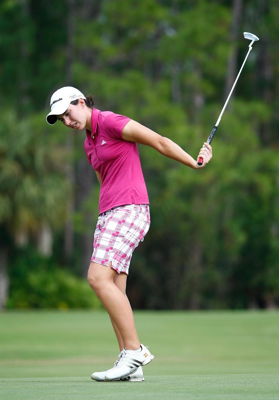 Carlota Ciganda of Spain reacts to a birdie attempt on the seventh hole during the third round of the CME Group Tour Championship at Tiburon Golf Club on November 22, 2014, in Naples, Florida (AFP Photo/Sam Greenwood)