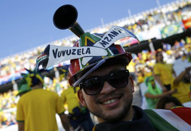A fan smiles before the opening ceremony of the 2014 World Cup at the Corinthians arena in Sao Paulo June 12, 2014. REUTERS/Kai Pfaffenbach (BRAZIL - Tags: SOCCER SPORT WORLD CUP)
