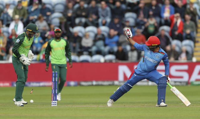 The bales fall as Afghanistan's Noor Ali Zadran is bowled by South Africa's Imran Tahir during the ICC Cricket World Cup group stage match at The Cardiff Wales Stadium in Cardiff, Wales, Saturday June 15, 2019. (David Davies/PA via AP)