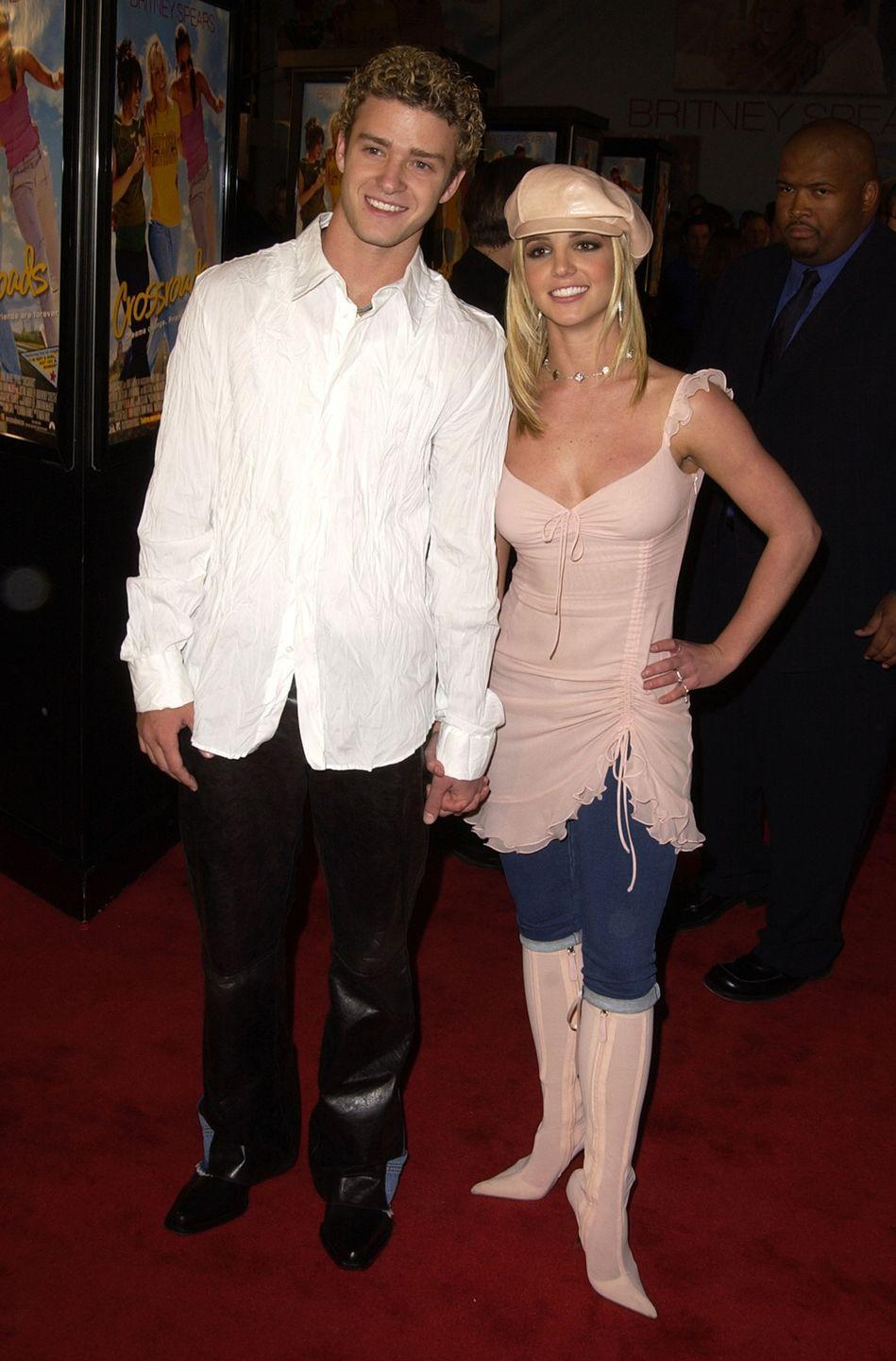 <p>I wasn't joking about the newsboy caps. But let's also quickly mention (1) the thigh-high boots, (2) the dress over jeans, and (3) JT's shiny pants because they are quite something.</p>