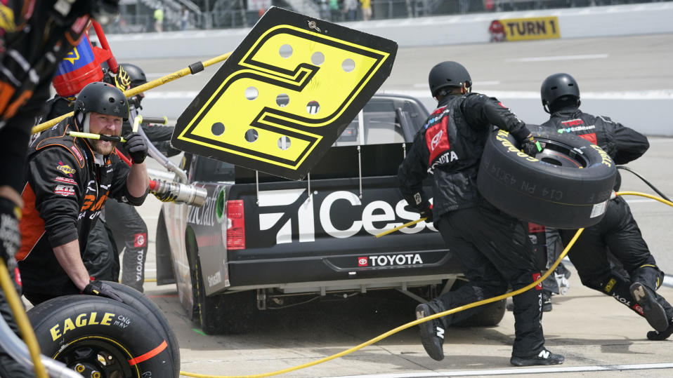 Kyle Busch (51) gets service in the pits during the NASCAR Truck Series auto race at Richmond International Raceway in Richmond, Va., Saturday, April 17, 2021. (AP Photo/Steve Helber)