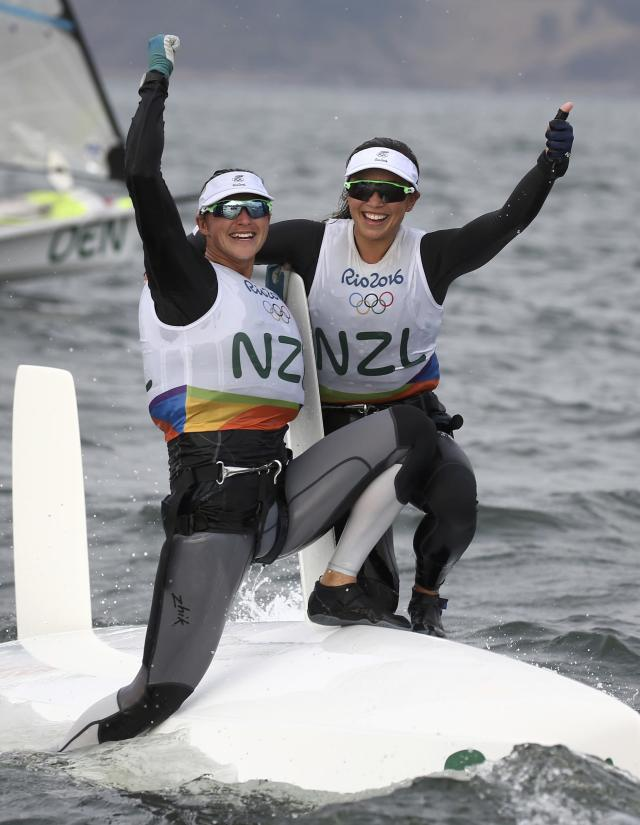 2016 Rio Olympics - Sailing - Final - Women's Skiff - 49er FX - Medal Race - Marina de Gloria - Rio de Janeiro, Brazil - 18/08/2016. Alex Maloney (NZL) of New Zealand and Molly Meech (NZL) of New Zealand celebrate silver medal. REUTERS/Benoit Tessier FOR EDITORIAL USE ONLY. NOT FOR SALE FOR MARKETING OR ADVERTISING CAMPAIGNS.