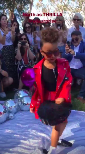 The 5-year-old showed off her modeling skills on a silver runway.