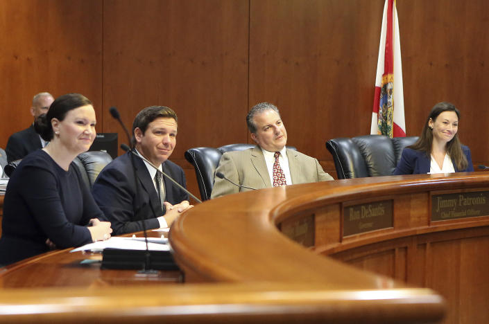 Gov. Ron DeSantis, second from left, presides over a Florida cabinet meeting in June 2019 in Tallahassee.