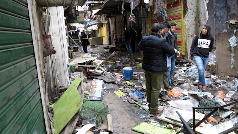 Iraqi security forces inspect the site of a bomb attack at a market in central Baghdad, Iraq December 31, 2016. REUTERS/Ali al-Mashhadani