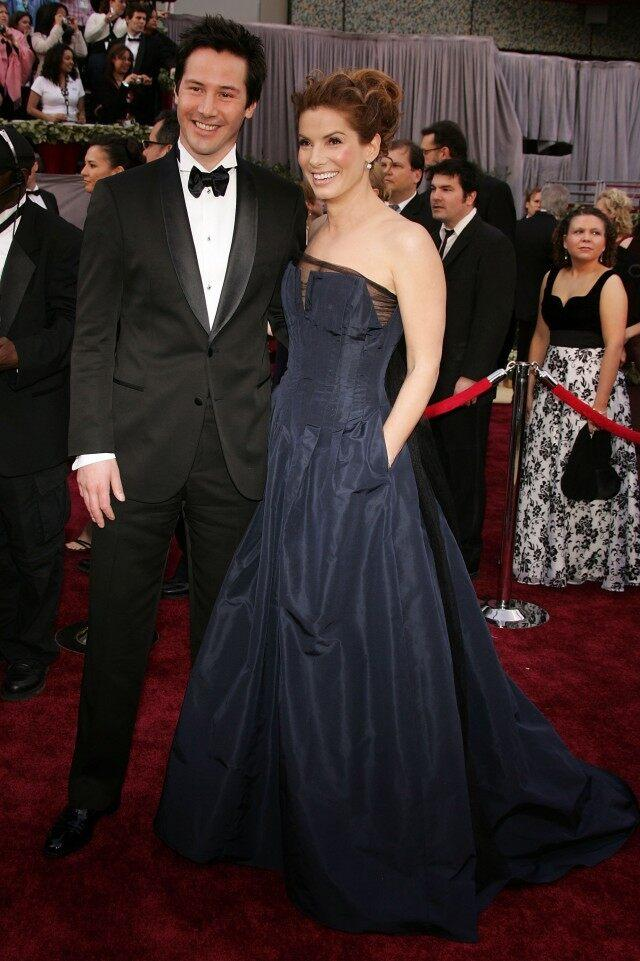 Sandra Bullock and Keanu Reeves arrive to the 78th Annual Academy Awards at the Kodak Theatre on March 5, 2006 in Hollywood, California.