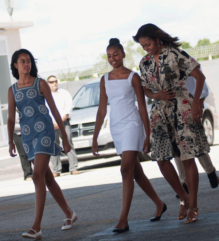 Michelle Obama with her two daughters, Sasha (center) and Malia (left).
